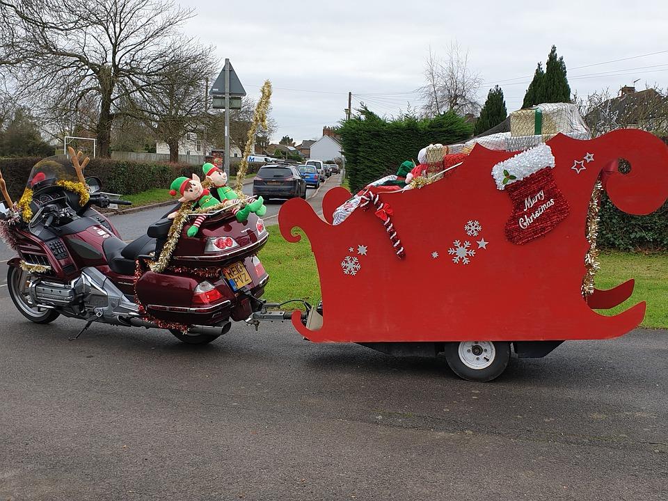 Santa Claus is riding a bike